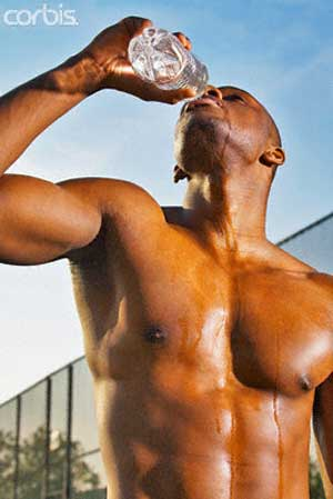 athlete drinking water Eight Powerful Foods for Muscle Mass