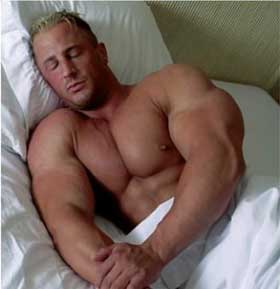 Huge bodybuilder sleeping to get fit