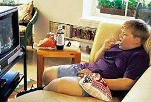 fat kid watching tv on couch
