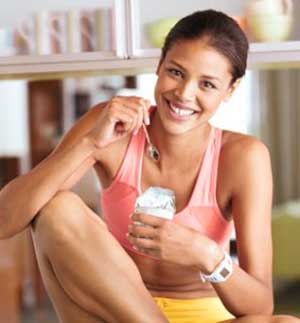 woman eating yogurt Eight Powerful Foods for Muscle Mass