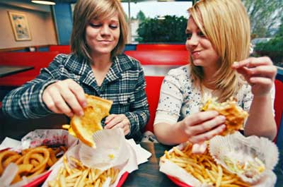 2 girls eating cheat meal at McDonald's restaurant