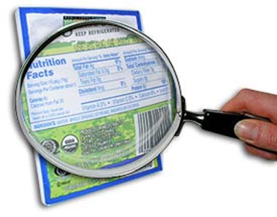 Magnifying glass looking at hidden ingredients in food