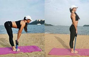 Squat exercises with resistance band done by woman