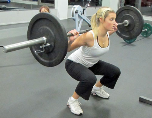 woman doing squats Reasons Why Weightlifting Will Help Your Bad Back