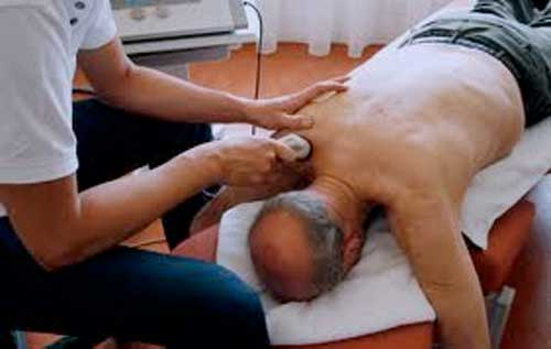 Man lying down get ultrasound therapy to back