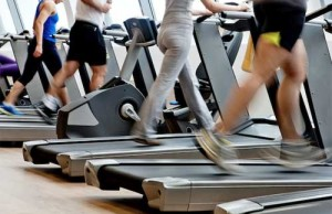 people-running-on-treadmill-at-gym